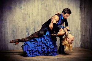 Two beautiful dancers perform the tango. Latin American dances.